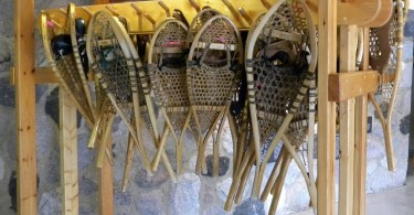 traditional snowshoes hanging on wooden rack