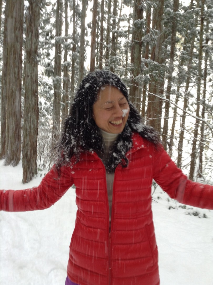 woman smiling and laughing in the snow, coping with cancer through visulaization