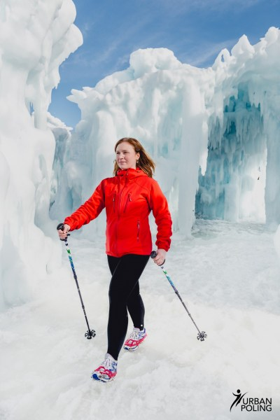 woman using Urban Nordic walking poles on icy conditions