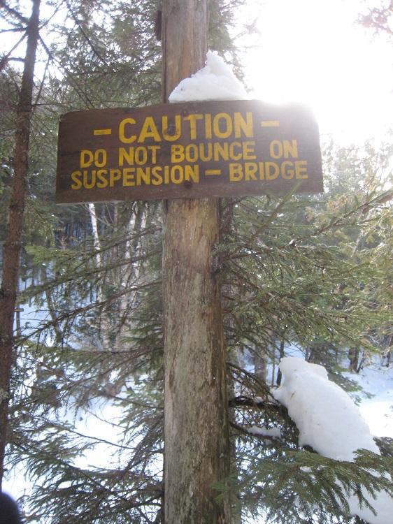 warning sign near the bridge