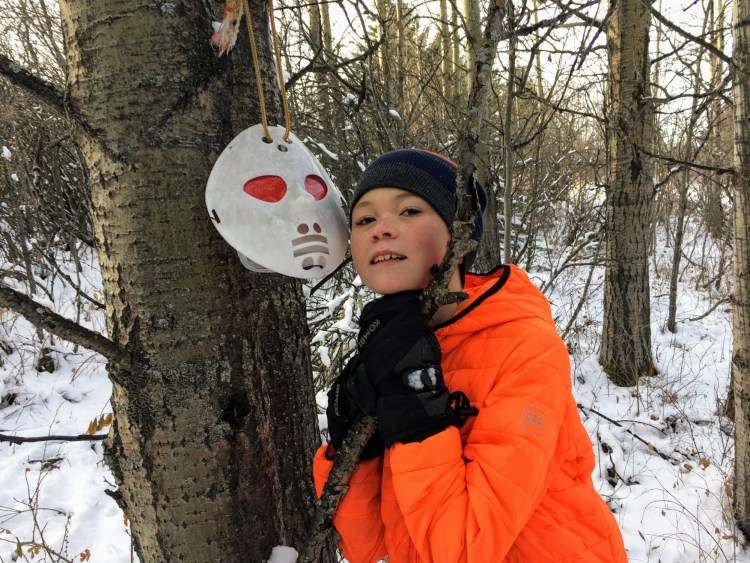 outdoor winter activities ideas: boy near geocaching mask
