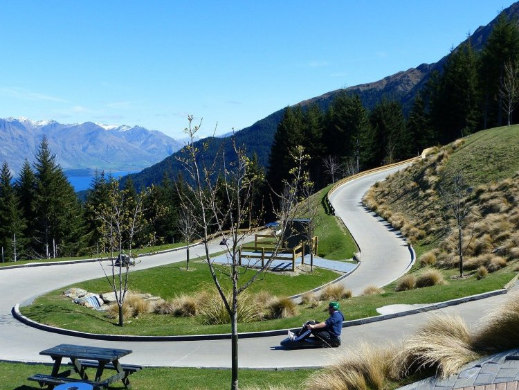 new sports to try: luge track in summer with mountains in background