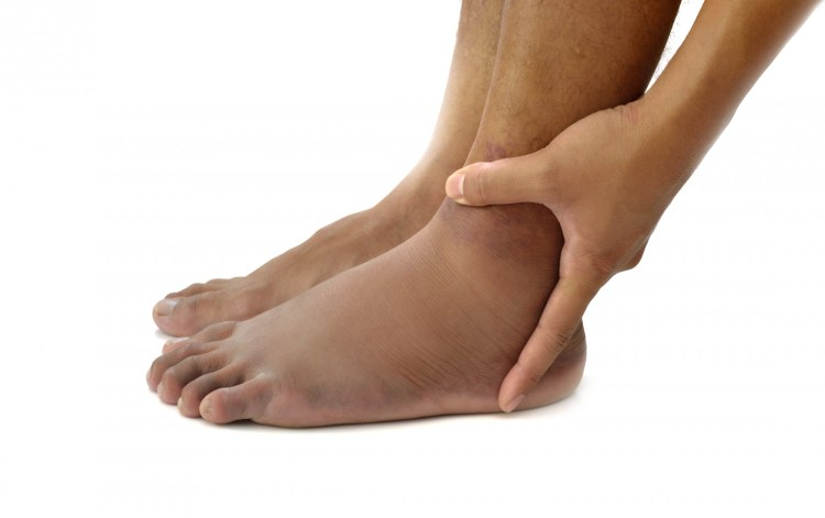 person holding ankle on white background