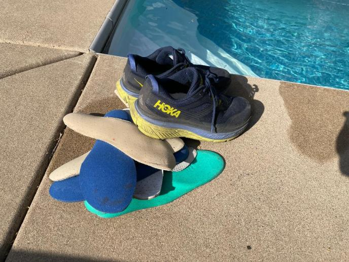 layers of shoe inserts near pool