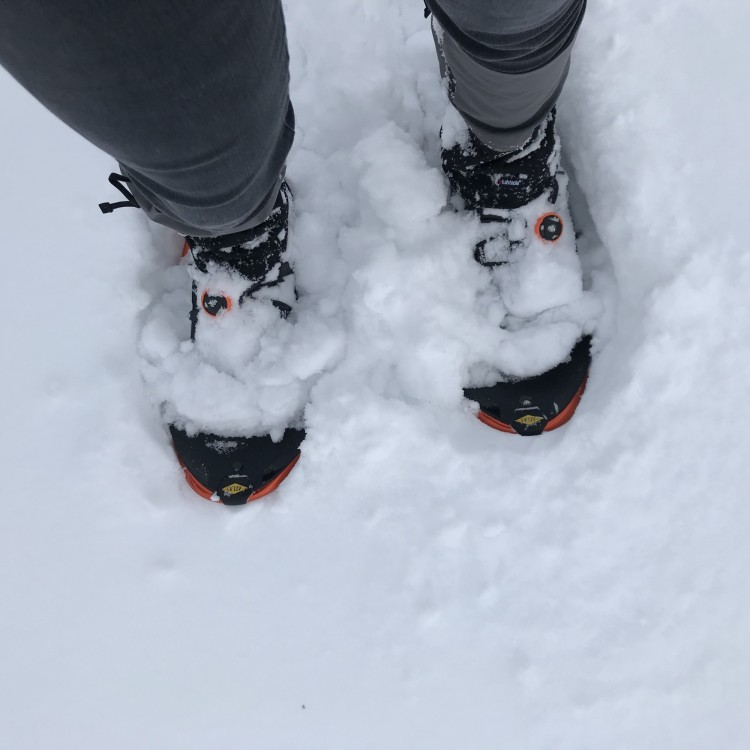 looking down on 'shoes filled with snow
