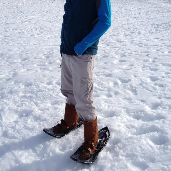 Trying out Manitobah mukluks while snowshoeing.  (Photo by Frank Meek.)
