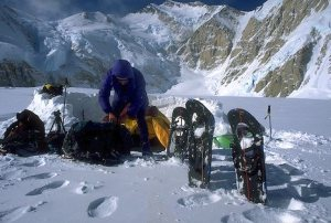 Photo of mountaineer checking his equipment at base camp
