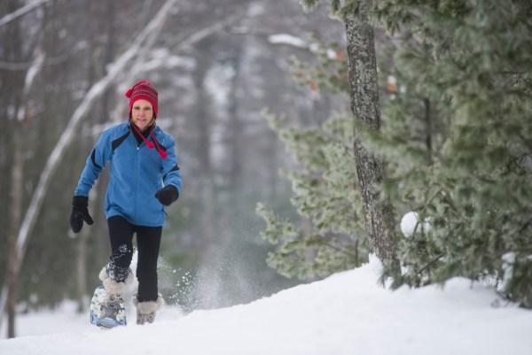 Woman snowshoeing in St. Germain