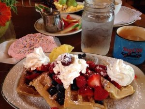 """A towering plate of breakfast goodies at Big City Coffee, where """"bigger is better."""""""