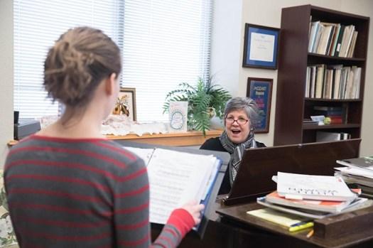 girl singing with music teacher