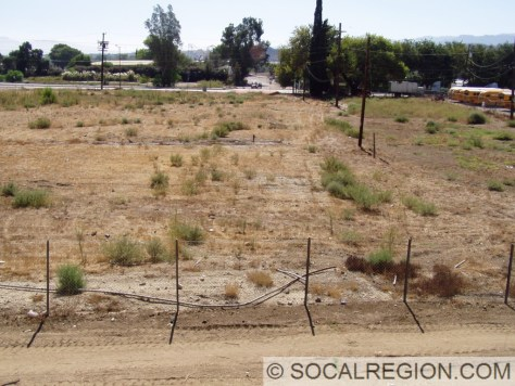 Site of the former Standard Oil gas station. A small portion of the 1932 paving is visible near the fence. In 1948, the roadway was shifted to the east.