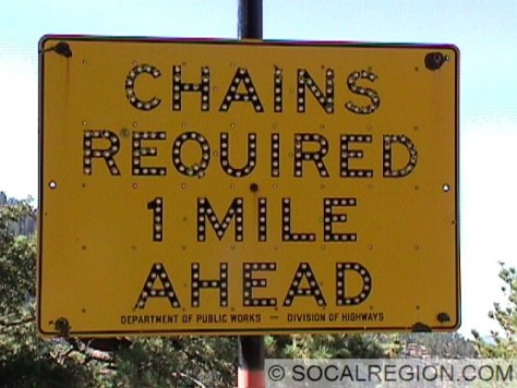 Chain Control sign from 1958. Sign has been since covered but is still there, just west of Cloudburst Summit.