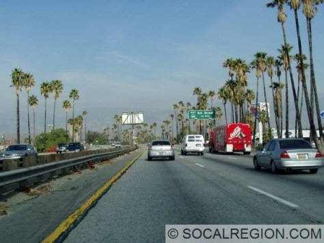 Typical stretch of the San Bernardino Freeway through San Bernardino. Here, as also in the last photo, smog mars the view of the mountains to the north.