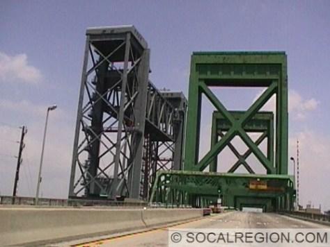 View of the bridges leaving Terminal Island on the freeway. Green bridge is the Schuyler Heim Bridge and the bridge to the left is for the railroad.