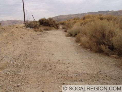Old alignment west of the present roadway.