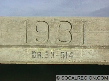 Close-up of culvert date stamp and bridge number.