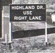 Close-up of the sign in the center of the photo. This sign was typical of the signage in 1955.