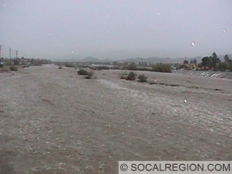 Santa Clara River during a flood in February 1998. Taken from the Sierra Highway bridge looking towards State Highway 14.