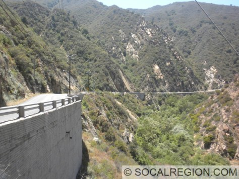 Large retaining walls along the canyon south of the tunnel.