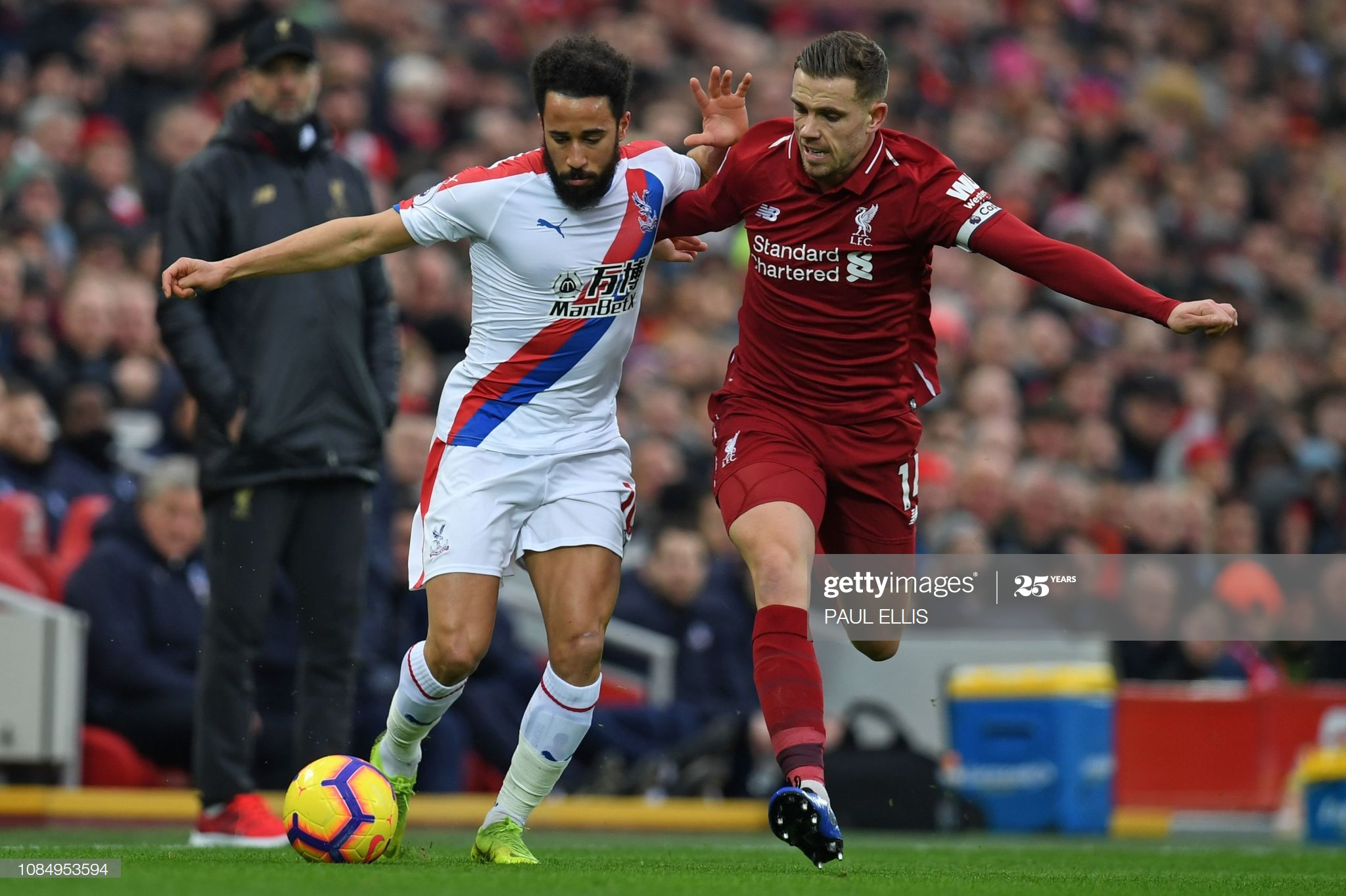 Crystal Palace's English midfielder Andros Townsend (L) vies with Liverpool's English midfielder Jordan Henderson (R) during the English Premier League football match between Liverpool and Crystal Palace at Anfield in Liverpool, north west England on January 19, 2019. (Photo by Paul ELLIS / AFP) / RESTRICTED TO EDITORIAL USE. No use with unauthorized audio, video, data, fixture lists, club/league logos or 'live' services. Online in-match use limited to 120 images. An additional 40 images may be used in extra time. No video emulation. Social media in-match use limited to 120 images. An additional 40 images may be used in extra time. No use in betting publications, games or single club/league/player publications. /         (Photo credit should read PAUL ELLIS/AFP via Getty Images)