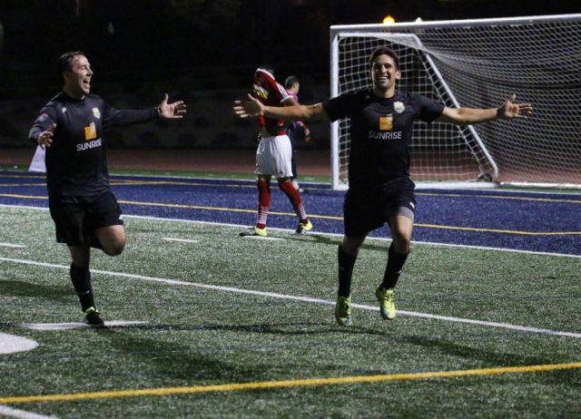 The Men in Black: NC Battalion players Tim Roty and Nelson Pizarro celebrate the final goal in their team's 5-3 NPSL playoff victory over Deportivo Coras on July 9th.