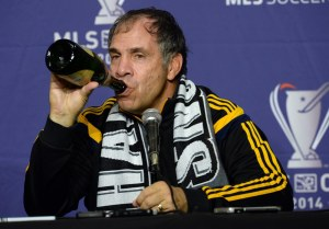 Dec 7, 2014; Los Angeles, CA, USA; Los Angeles Galaxy head coach Bruce Arena drinks from a bottle of champagne at a press conference after the 2014 MLS Cup final against the New England Revolution at Stubhub Center. Mandatory Credit: Jayne Kamin-Oncea-USA TODAY Sports ORG XMIT: USATSI-189486 ORIG FILE ID: 20141207_jla_aj4_301.jpg