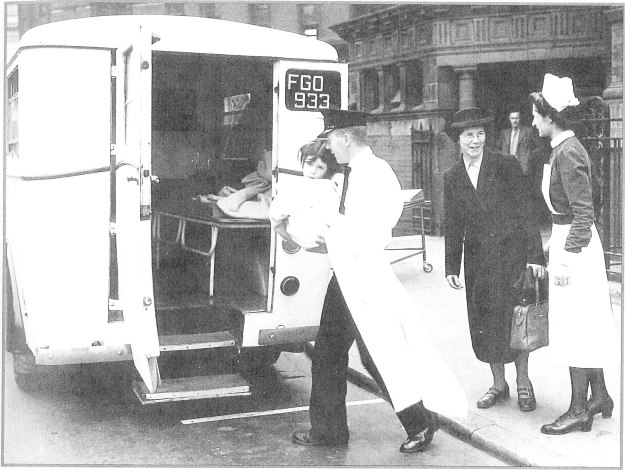 Child carried into ambulance about 1950