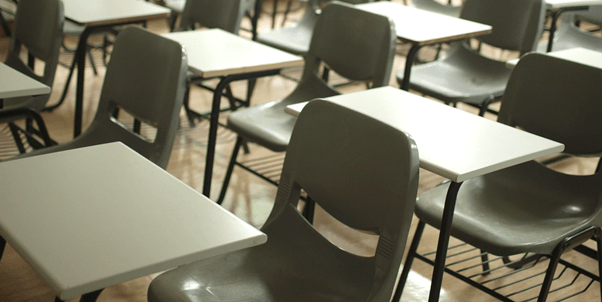 Image of empty chairs in a school classroom