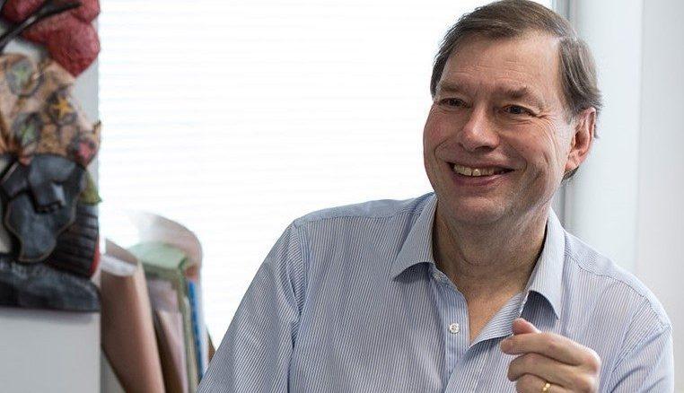 John Hills at his desk