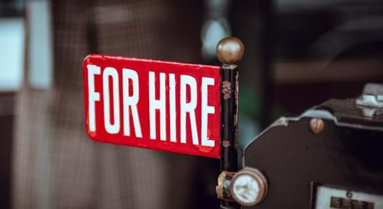 image of red sign stating 'for hire'