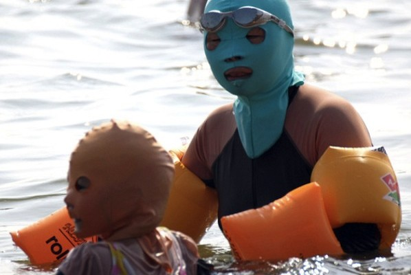 Beach goer wears a face-kini