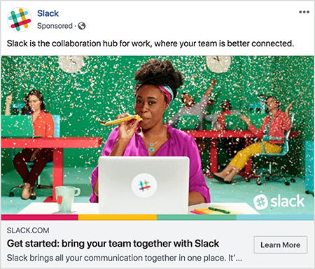 "This is a screenshot of a Facebook ad for Slack. The ad text says ""Slack is the collaboration hub for work, where your team is better connected."" In the ad image, a black woman sits at a desk with a gray laptop. Her hair is short and held back with a colorful headband. She's wearing a fuschia blouse and turquoise necklace, and she's blowing through a yellow noisemaker. In the background, other people are sitting at desks and wearing colorful clothing. The office is painted bright green, and confetti is falling from the ceiling. Talia Wolf recommends using photos like this, which show raw emotion, in your ads."