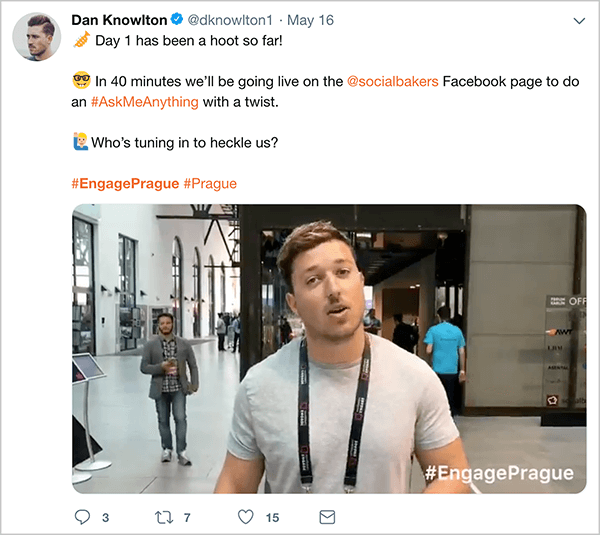 "This is a screenshot of a tweet Dan Knowlton posted about the Engage Prague event. The text says ""Day 1 has been a hoot so far! In 40 minutes, we'll be going live on the @socialbakers Facebook page to do an #AskMeAnything with a twist. Who's tuning in to heckle us? #EngagePrague #Prague"". Below this text is a video that shows highlights of the first day of the event. In the video still, Dan is speaking to the camera in an open conference space. Dan appears from the waist up. He's a white man with short brown hair. He's wearing a gray t-shirt and a black lanyard."