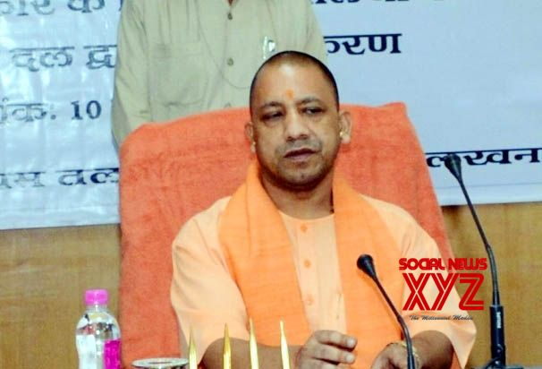EC ban on, Yogi lands in Ayodhya, meets sants