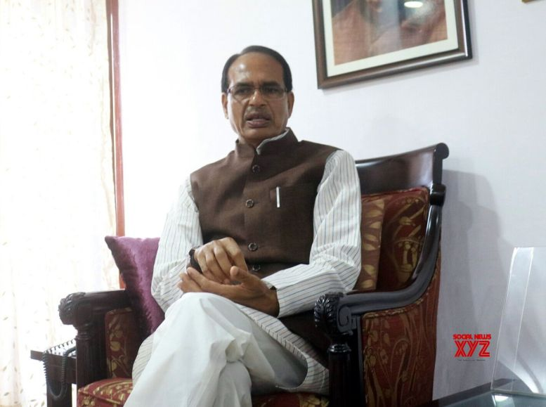 Chauhan meets MP CM, points to law & order