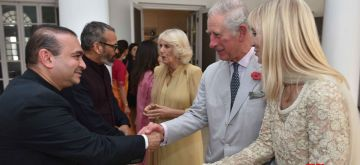 Billionaire diamond trader Nirav Modi (R) shakes hands with TRH Charles, Prince of Wales and Camilla, Duchess of Cornwall. A day after a massive $1.8 billion fraud was unearthed in a PNB branch in Mumbai, the Enforcement Directorate launched a nationwide raid on Modi's the offices, showrooms and workshops.The multi-pronged action came a day after the Punjab National Bank admitted to unearthing a fraud of Rs 11,515 crore involving Modi's companies and certain other accounts with the bank's flagship branch (Brady House) in Mumbai and its second largest lending window in India.The fraud, which includes money-laundering among others, concerns the Firestar Diamonds group in which the CBI last week booked Modi, his wife Ami, brother Nishal and a maternal uncle Mehul Choksi.It is learnt that Modi - whose operations are spread across Europe, the US, Middle East and Far East besides India - has written to PNB and other banks that he would return their outstandings. (File Photo: IANS)