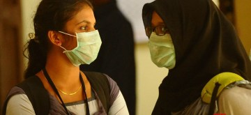 Kozhikode (Kerala): Students wear safety masks as a precautionary measure after the outbreak of 'Nipah' virus in Kozhikode, Kerala on May 22, 2018. (Photo: IANS)
