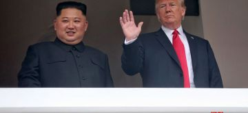 Singapore: U.S. President Donald Trump waves on the veranda of the Capella Hotel in Singapore on June 12, 2018, while having a one-on-one summit with North Korean leader Kim Jong-un in this photo provided by Singapore's Ministry of Communications and Information.(Yonhap/IANS)