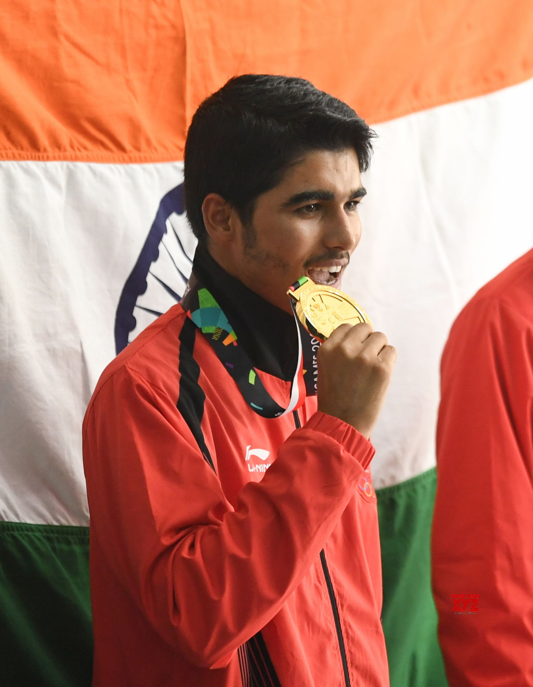 (180821) -- PALEMBANG, Aug. 21, 2018 (Xinhua) -- Saurabh Chaudhary of India reacts during the awarding ceremony of the men's 10m Air Pistol final  at the 18th Asian Games in Palembang, Indonesia on Aug. 21, 2018. (Xinhua/Liu Ailun)