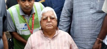 Patna: RJD chief Lalu Prasad Yadav arrives at Jai Prakash Narayan Airport after undergoing treatment in Mumbai; in Patna on Aug 25, 2018. (Photo: IANS)