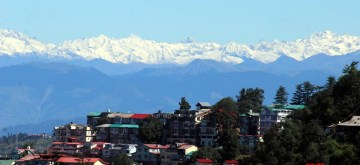 Shimla: A view of snow clad mountains on a sunny day after the upper reaches of Himachal Pradesh received fresh snowfall, as seen from Shimla on Sept 26, 2018. (Photo: IANS)