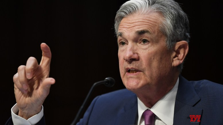 US Federal Reserve raises lending rate; signals slower pace ahead