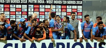 Chennai: Indian cricket team celebrates with the trophy after wining the 3rd T20 match between India and West Indies in Chennai on Nov. 11, 2018. India won the T20 series 3-0. (Photo: IANS)
