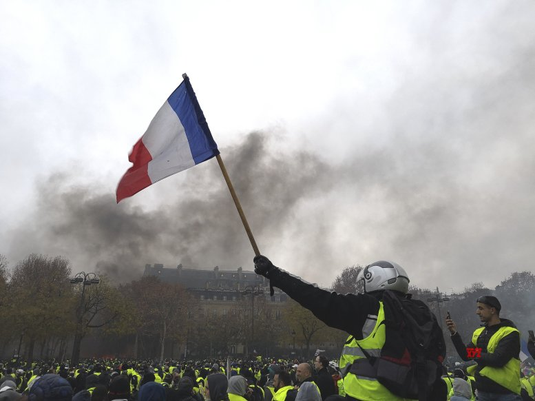 French police use tear gas on protesters as tensions rise