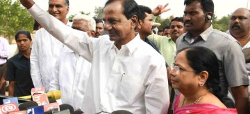 Hyderabad: Telangana caretaker Chief Minister and TRS president K Chandrasekhar Rao accompanied by his wife K. Shobha shows victory sign after casting his vote for Telangana Assembly elections in Hyderabad on Dec 7, 2018. (Photo: IANS)