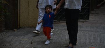 Mumbai: Actor Saif Ali Khan's son Taimur seen outside his residence in Mumbai on Dec 23, 2018. (Photo: IANS)