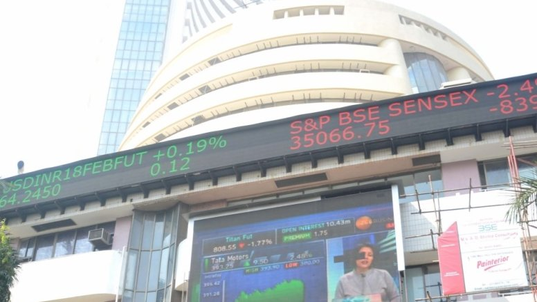 Sensex ends at record closing level amid choppy trade