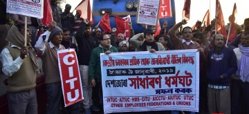 """Guwahati: Trade Union members stage a demonstration on railway tracks disrupting railway services on the first day of the two-day nationwide strike called by central trade unions (CTUs) to protest against """"anti-labour, anti-people and anti-national policies"""" of the Narendra Modi-led Central Government, in Guwahati on Jan 8, 2019. (Photo: IANS)"""