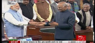 New Delhi: Prime Minister Narendra Modi shakes hands with President Ram Nath Kovind during a joint session of Lok Sabha and Rajya Sabha at Parliament in New Delhi on Jan 31, 2019. (Photo: IANS/RSTV)