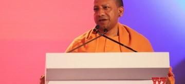 "Varanasi: Uttar Pradesh Chief Minister Yogi Adityanath addresses at the first plenary session on ""Engagement with younger members of Indian Diaspora"" at Pravasi Bhartiya Divas 2019 in Varanasi, on Jan 21, 2019. (Photo: IANS/MEA)"